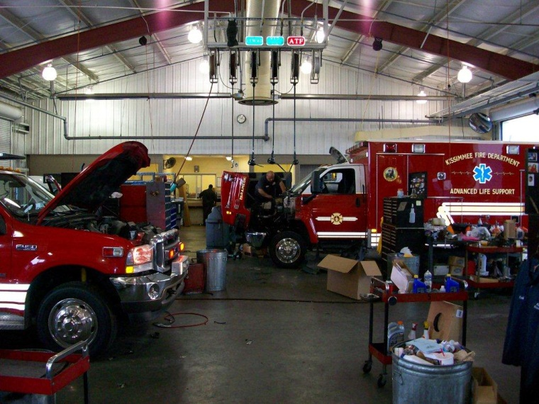 Ambulance and other fire vehicles being maintained at central services