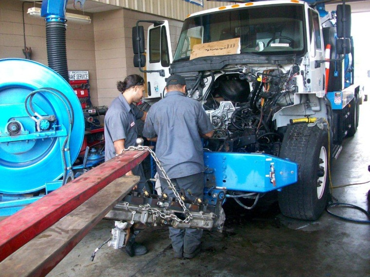 Staff Working on a truck at Central Services