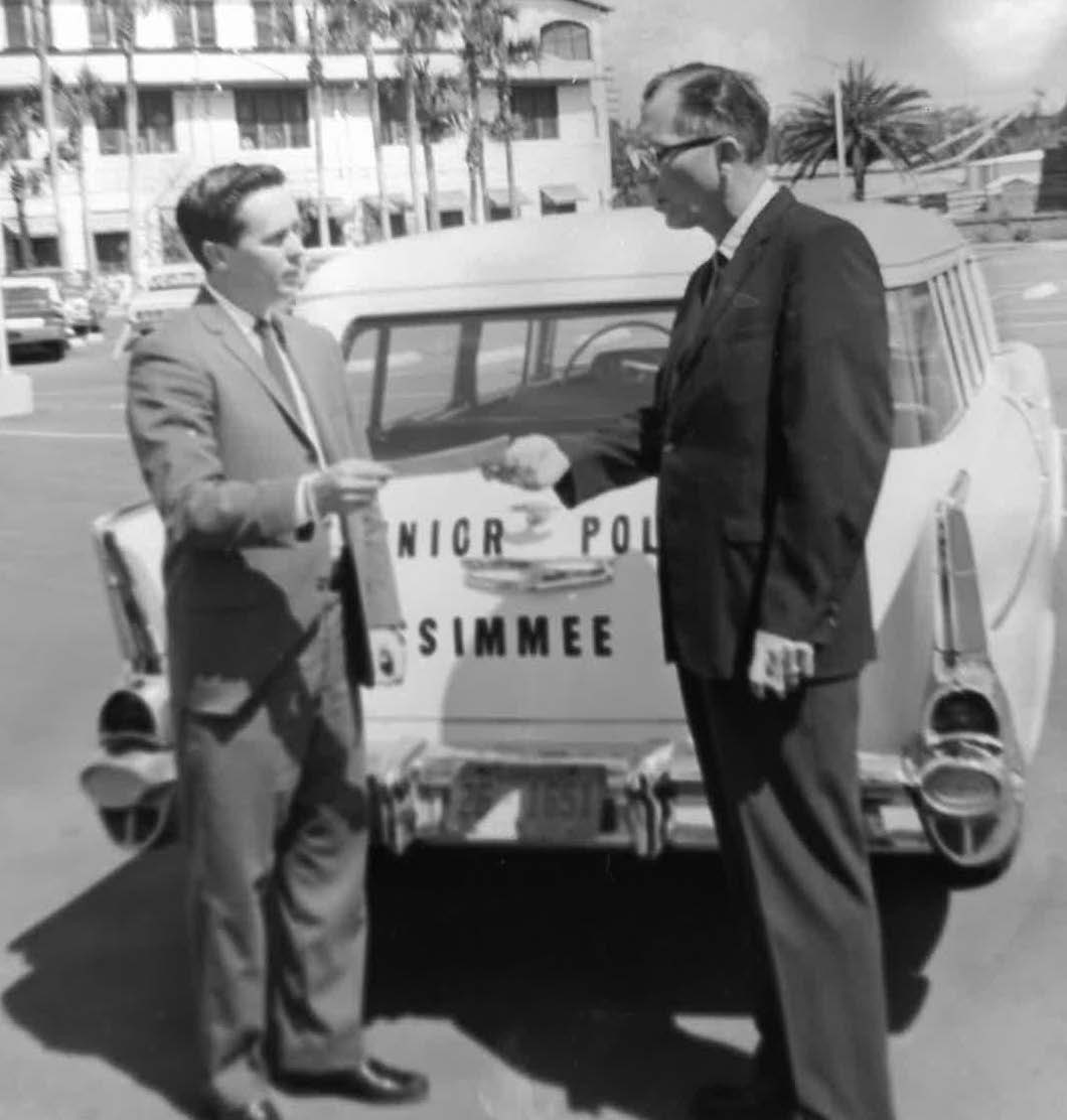 Picture of 1950's Kissimmee Police Department vehicle with two detectives