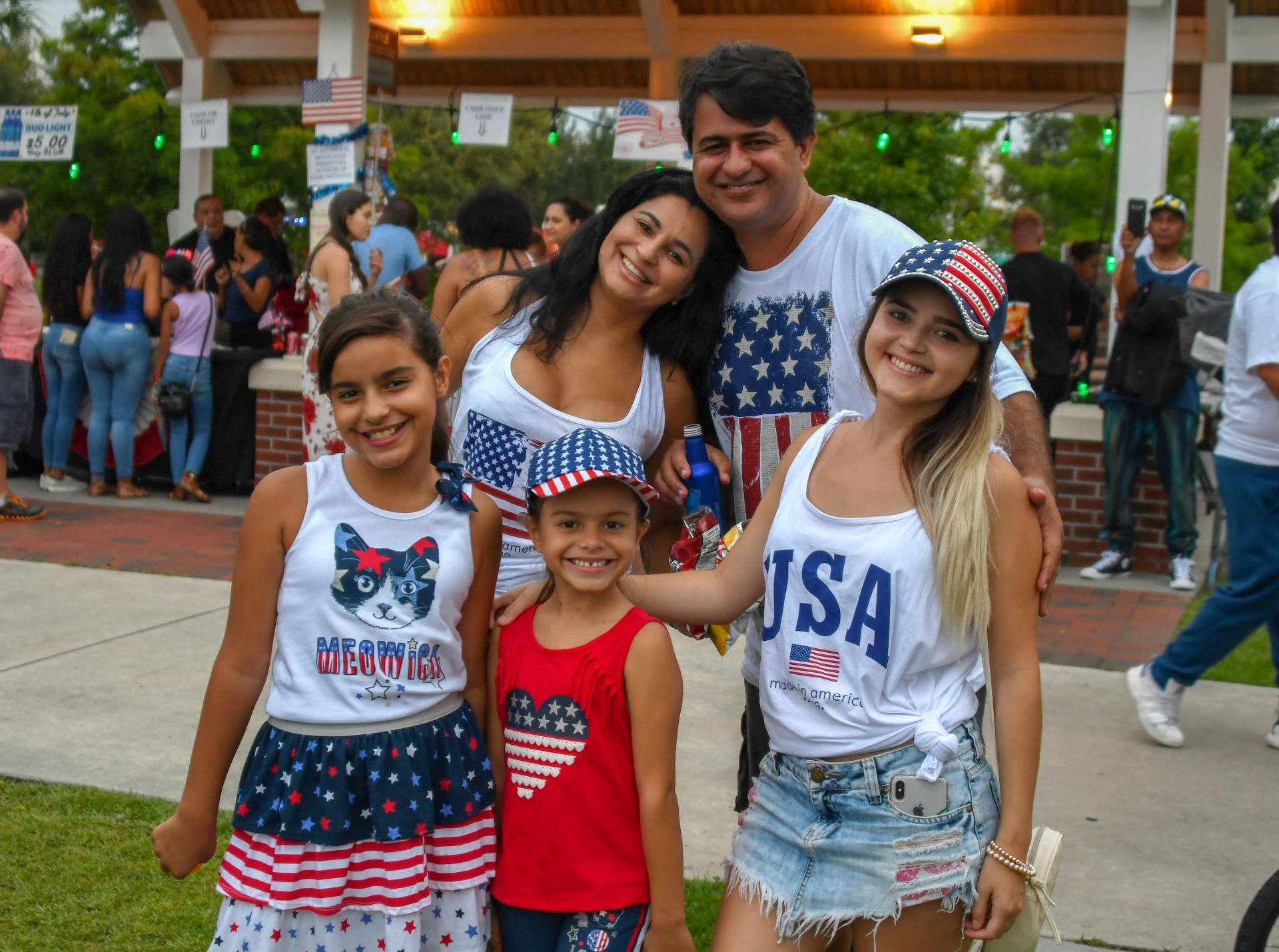 This is a photo of a family dressed in red, white and blue clothing celebrating the 2019 Monumental 4th of July.