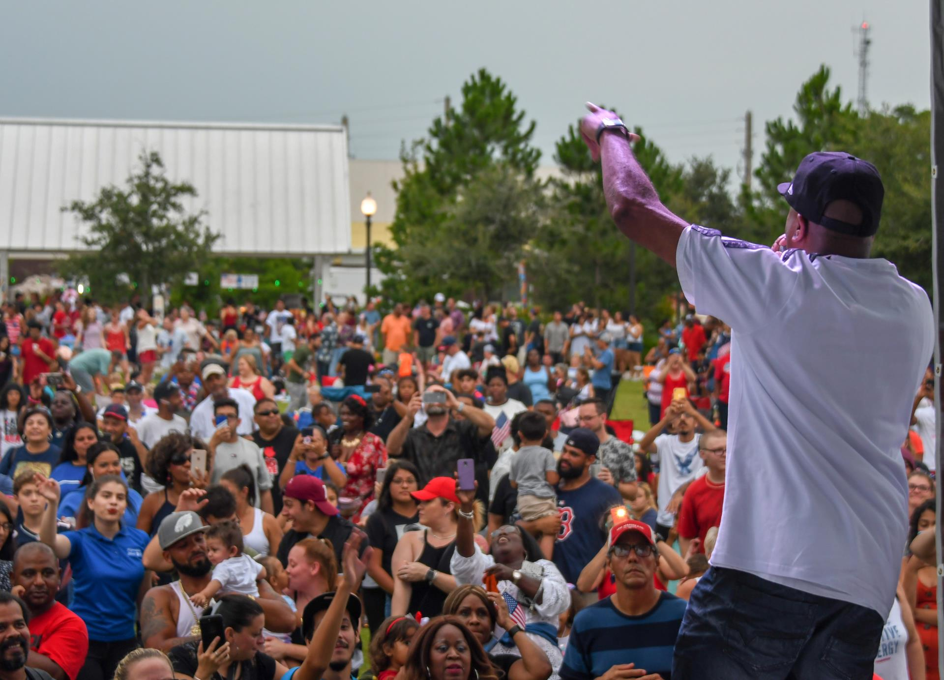 This is a photo of Rob Base performing in front of a large crowd at the 2019 Monumental 4th of July.