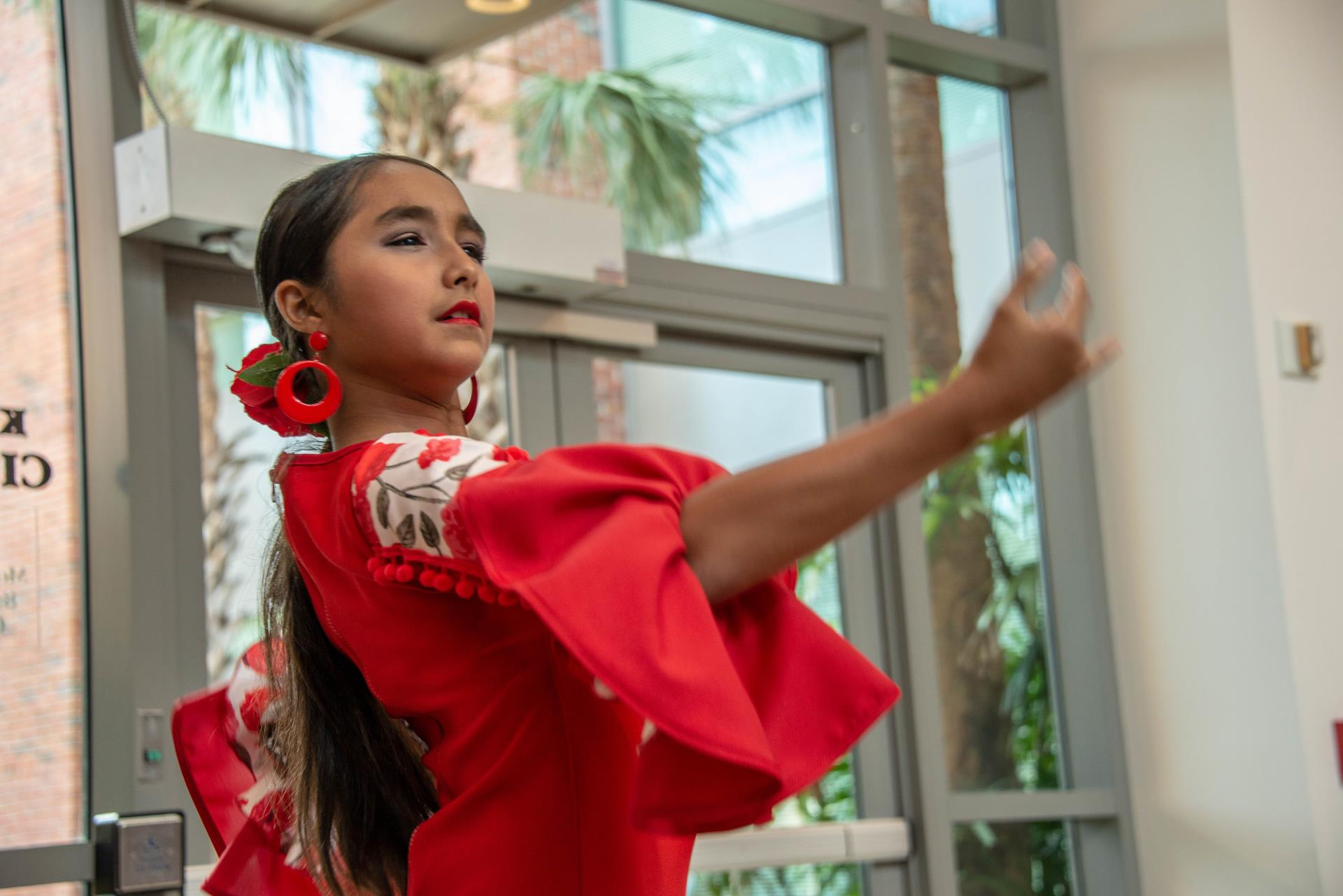 This is a photo of a girl dancing at the City of Kissimmee Hispanic Heritage Month Reception