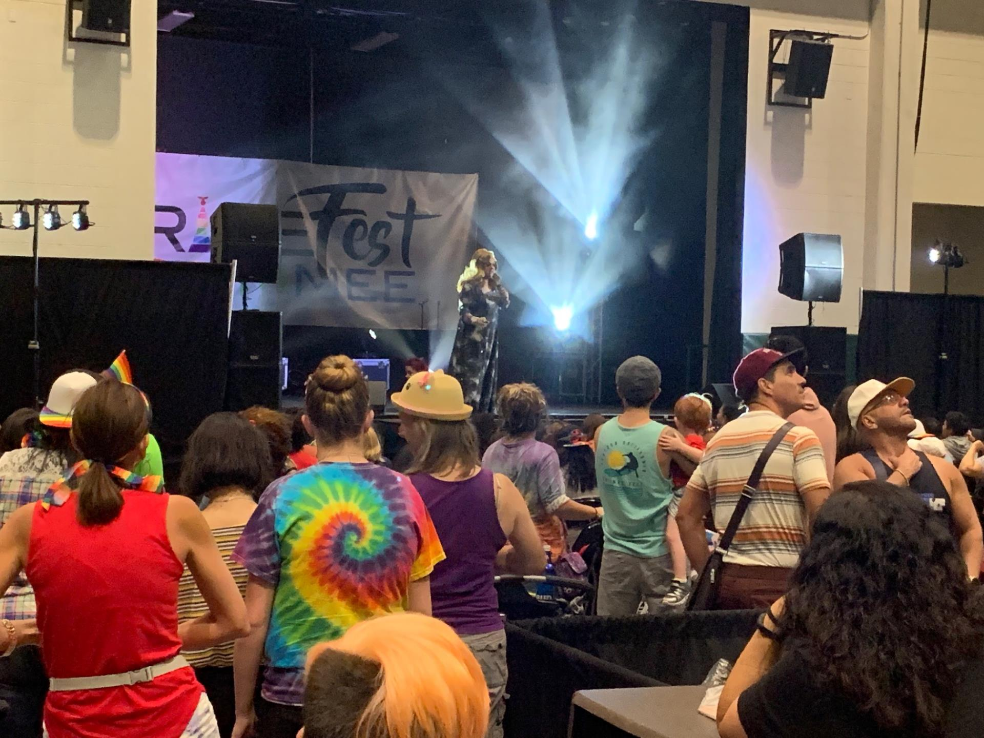 This is a photo of a live performer on stage at Pridefest Kissimmee at the Kissimmee Civic Center