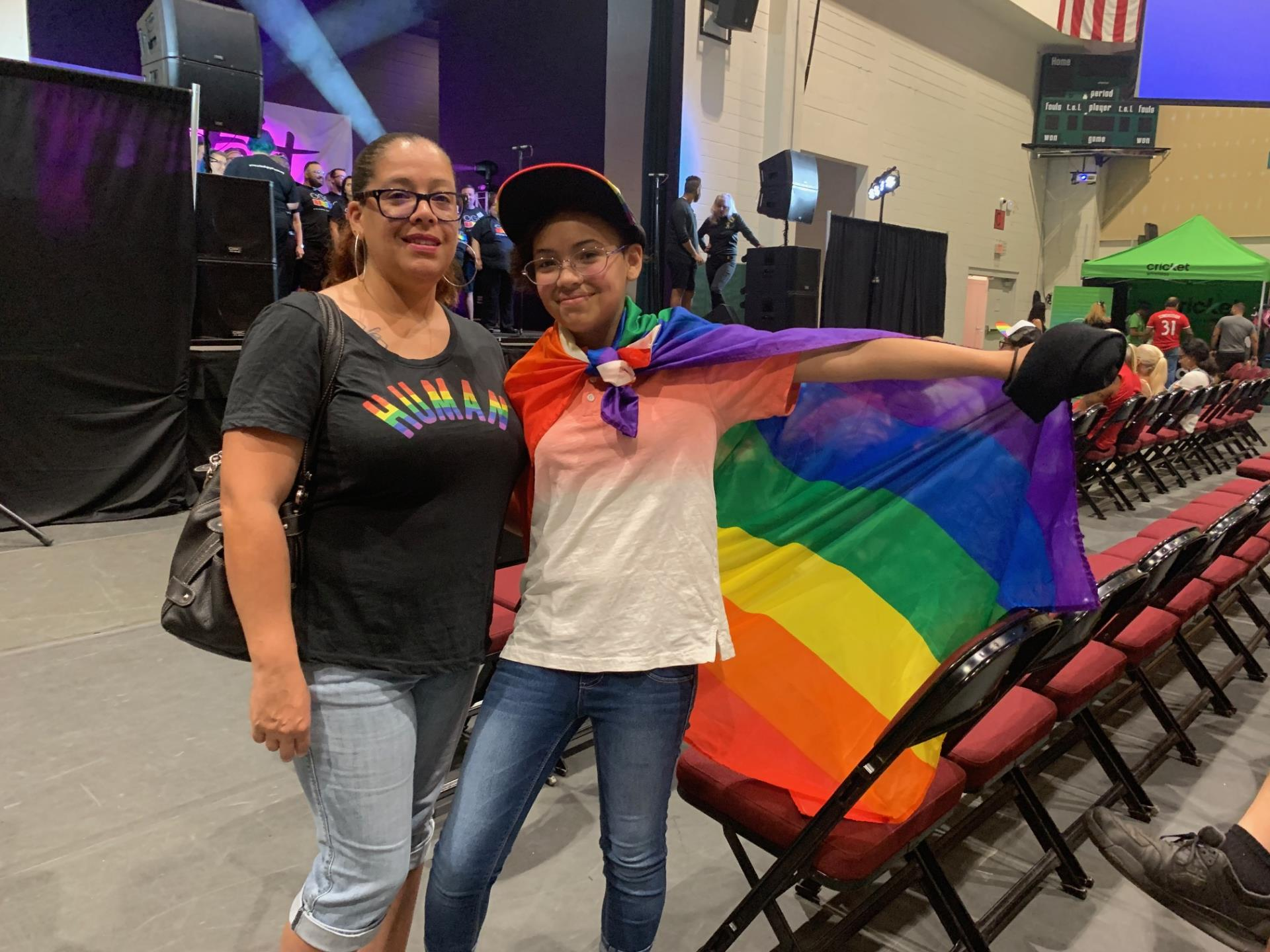 This is a photo of a boy and woman with a rainbow flag at Pridefest Kissimmee at the Kissimmee Civic Center